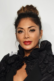 Nicole Scherzinger wore her hair piled on top of her head in a voluminous knot when she attended the American Ballet Theatre 75th anniversary gala.