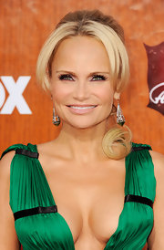 Kristin Chenoweth wore her hair in a pretty ponytail with long face-framing bangs at the 2011 American Country Awards.