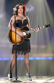 Angaleena Presley wore a 1940's-inspired little black dress while onstage at the American Country Awards.