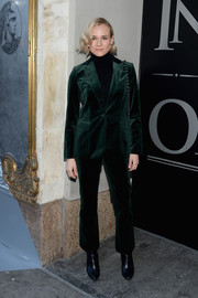 Diane Kruger went for a mannish vibe in a dark-emerald velvet suit by FRAME when she attended the American Express Platinum Card celebration.