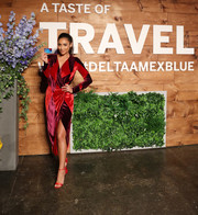 Shay Mitchell cut a chic figure in a harlequin-patterned color-block wrap dress during Amex and Delta Air Lines' A Taste of Travel event.