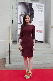 Alexis looked charming in a sophisticated maroon cocktail dress with a retro silhouette at the premiere of 'The Conspirator.'