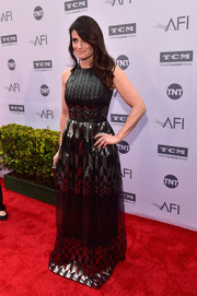 Idina Menzel attended the AFI Life Achievement Award looking glamorous in a metallic gown.