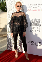 Noomi Rapace was edgy-chic in a sheer black lace top paired with leather skinnies at the American Friends of Covent Garden 50th anniversary celebration.