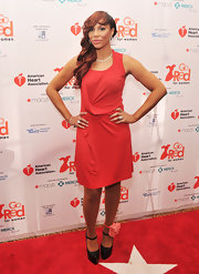 Tamar Braxton topped off her look with black platform pumps.