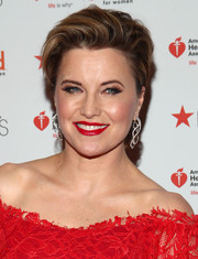 Lucy Lawless worked a short, tousled hairstyle at the Go Red for Women event.