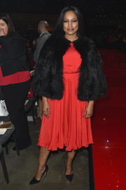 Garcelle Beauvais chose a classic pleated cocktail dress for the Go Red for Women event.
