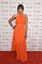 Cynthia Bailey looked vibrant and chic in a pleated orange halter gown during the American Heart Association Go Red for Women event.