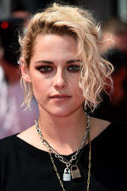 Kristen Stewart was her usual rocker-chic self at the Cannes premiere of 'American Honey,' where she wore this messy, loose bun with curly tendrils hanging down one side of her face.