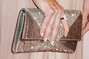 Denise Richard's metallic sparkly clutch was a blinged out bonus to her shimmering pink gown.