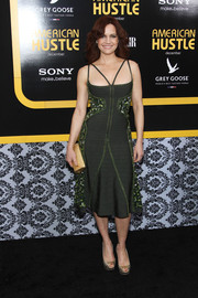 Carla Gugino perfectly matched her dress with elegant gold python peep-toes.