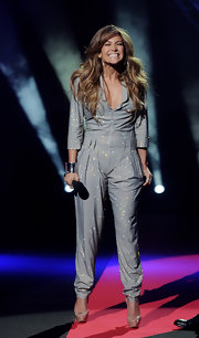 Jennifer Lopez showed off her sparkling silver jumpsuit while making her first appearance at the American Idol show.