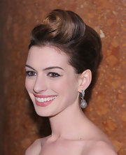 Anne Hathaway paired her voluminous updo with diamond drop earrings.
