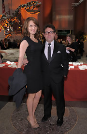 Tina Fey paired a bold shouldered LBD with classic nude platform pumps.