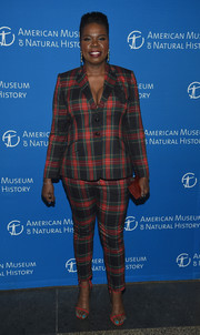 Leslie Jones teamed her suit with red ankle-strap sandals by Stuart Weitzman.