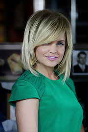 Mena Suvari wore her choppy bob with long side-swept bangs at a photocall for 'American Pie: Reunion.'