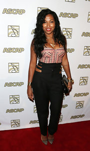 Melanie Fiona rocked a tribal-print corset top with a pair of high-waist black pants.