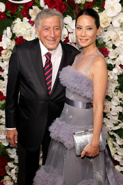 Lucy Liu teamed a metallic silver clutch with a frothy lavender gown for the American Theatre Wing Centennial Gala.