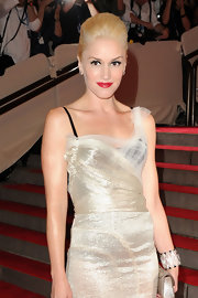 Musician and designer Gwen Stefani went for a high pompadour while hitting the red carpet for the MET Gala. Her shiny mauve lips gave her look a pop of color.