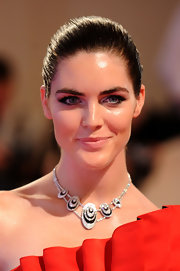 Hilary Rhoda showed off one of the best hairstyles for spring the slick bun. It's a great way to show off your natural features and stunning make-up.