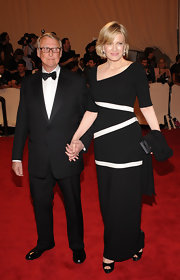 Diane Sawyer looked chic and modern at the Costume Institute Gala in a black evening dress featuring an asymmetrical neckline and white stripes.