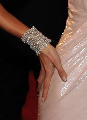 The super model showed off her diamond clad bracelet while hitting the red carpet. Her bracelet was a nice accent to her curve hugging dress.