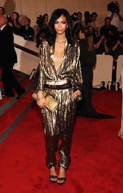 Chanel looked like perfection at the Met Gala in a gold lame' jumpsuit.