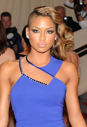 Cassie showcased her long curls and half shaven hair while hitting the red carpet in her cobalt blue Versace dress.