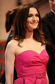 Actress Rachel Weisz kept her look sleek and contemporary with a simple center part and loose curls.