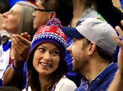 Olivia Wilde cheered on the Kansas Jayhawks in a knit pompom beanie.