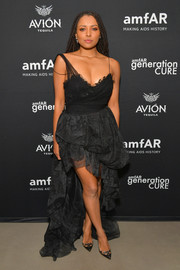 Kat Graham was goth-glam in a black Ermanno Scervino gown with a puffy high-low skirt at the amfAR GenCure Solstice 2018.
