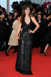 Berenice Marlohe arrived at the 'Amour' premiere wearing a silver crystal cuff and carrying a jet crystal clutch.
