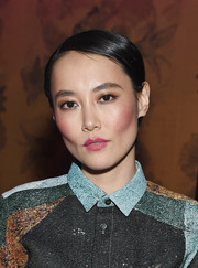 Rinko Kikuchi styled her hair into a slick side-parted 'do for the screening of 'Kumiko, the Treasure Hunter.'
