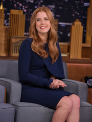 Amy Adams kept it conservative in a long-sleeve navy sheath dress with a bodice overlay during her 'Jimmy Fallon' appearance.
