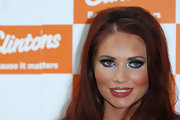 Amy Childs wore a combination of eye-opening turquoise, violet and fuchsia shadows at a signing of her 2011 calendar.