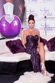 Amy Childs stuck to sparkles, flashing a shimmery pair of silver sandals underneath an even more glittery plum sequin dress.