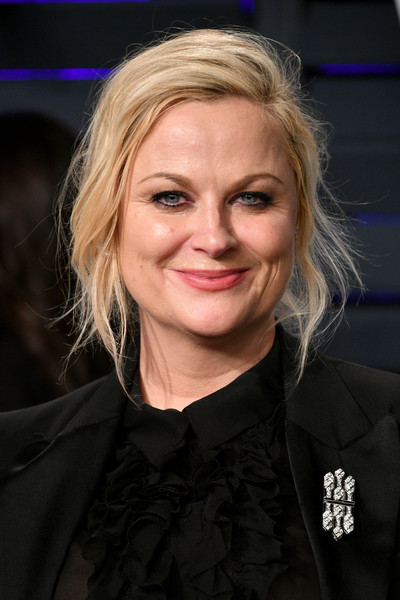 Amy Poehler Messy Updo [oscar party,vanity fair,hair,face,blond,hairstyle,eyebrow,chin,cheek,forehead,smile,official,beverly hills,california,wallis annenberg center for the performing arts,radhika jones - arrivals,radhika jones,amy poehler]