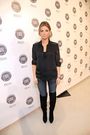 Amber Lancaster stayed on trend in black slouchy over the knee bots. She paired the stylish boots with jeans and an embellished black button down.