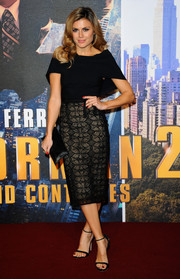 Zoe Hardman hit the 'Anchorman 2' red carpet looking ultra chic in a caped black cocktail dress with a lace skirt.