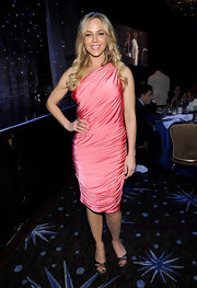 Julie Benz sizzled in a hot pink one-shoulder knit dress with thick gathers for Andrea Bocelli's benefit.