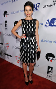 Camilla Belle donned a tasseled cocktail dress to the Andrea Bochelli benefit in Beverly Hills.
