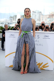 Marion Cotillard went for a cute Adam Selman gingham romper with a flowing overskirt at the Cannes Film Festival photocall for 'Angel Face.'