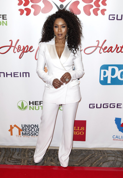 Angela Bassett looked spiffy in a white Ester Abner pantsuit at the Hearts for Hope Gala.