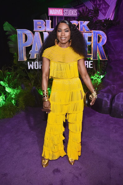 Angela Bassett Jumpsuit [black panther,yellow,purple,carpet,fashion,premiere,flooring,fashion design,red carpet,style,performance,angela bassett,california,hollywood,dolby theatre,marvel studios,los angeles world premiere]