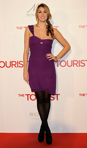 Priscila brightens up the red carpet in a purple cocktail dress.