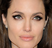 Angelina Jolie added drama to her natural look with lush lashes. Nude shimmering gloss completed her look.
