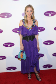 Nicky Hilton Rothschild embraced color, pairing her purple frock with a turquoise, orange, and red leather purse by Anya Hindmarch.