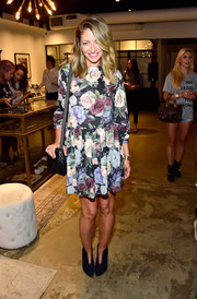 Rebecca Gayheart attended the Anine Bing Los Angeles flagship opening looking sweet in a rose-print mini dress.