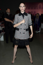 Coco Rocha layered a patterned gray blazer over a little black lace dress for the Anna Sui fashion show.