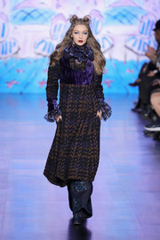 Gigi Hadid walked the Anna Sui runway wearing a Victorian-chic tweed and velvet coat dress.